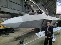 Kristin - with a camo fighter jet